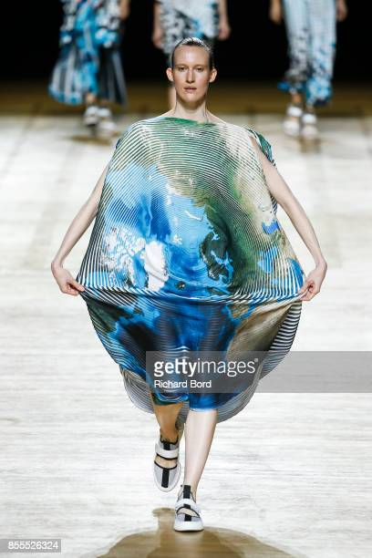 Model walks the runway during the Issey Miyake show at Grand Palais as part of Paris Fashion Week Womenswear Spring/Summer 2018 on September 29, 2017...