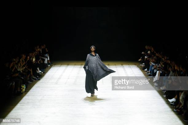 A model walks the runway during the Issey Miyake show at Grand Palais as part of Paris Fashion Week Womenswear Spring/Summer 2018 on September 29...