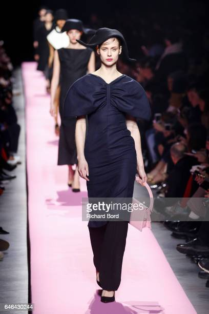 A model walks the runway during the Jacquemus show as part of the Paris Fashion Week Womenswear Fall/Winter 2017/2018 on February 28 2017 in Paris...
