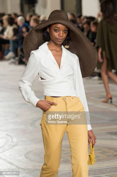 A model walks the runway during the Jacquemus show as part of the Paris Fashion Week Womenswear Fall/Winter 2018/2019 on February 26 2018 in Paris...