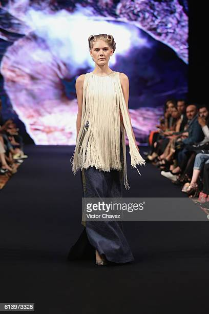 Model walks the runway during the Jannette Klein show at Mercedes-Benz Fashion Week Mexico Spring/Summer 2017 at Ex Convento De San Hipolito on...