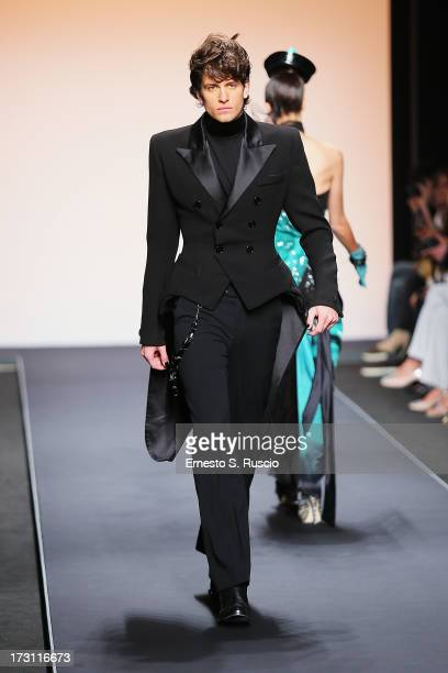 A model walks the runway during the Jean Paul Gaultier Couture fashion show as part of AltaRoma AltaModa Fashion Week Autumn/Winter 2013 on July 7...