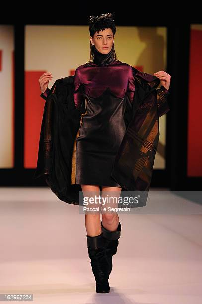 Model walks the runway during the Jean Paul Gaultier Fall/Winter 2013 Ready-to-Wear show as part of Paris Fashion Week on March 2, 2013 in Paris,...