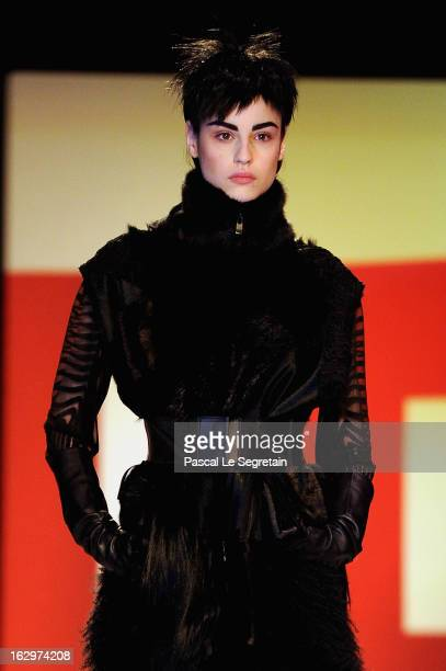 A model walks the runway during the Jean Paul Gaultier Fall/Winter 2013 ReadytoWear show as part of Paris Fashion Week on March 2 2013 in Paris France