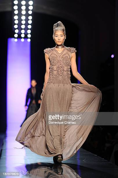 A model walks the runway during the Jean Paul Gaultier Haute Couture Fall/Winter 2011/2012 show as part of Paris Fashion Week on July 6 2011 in Paris...
