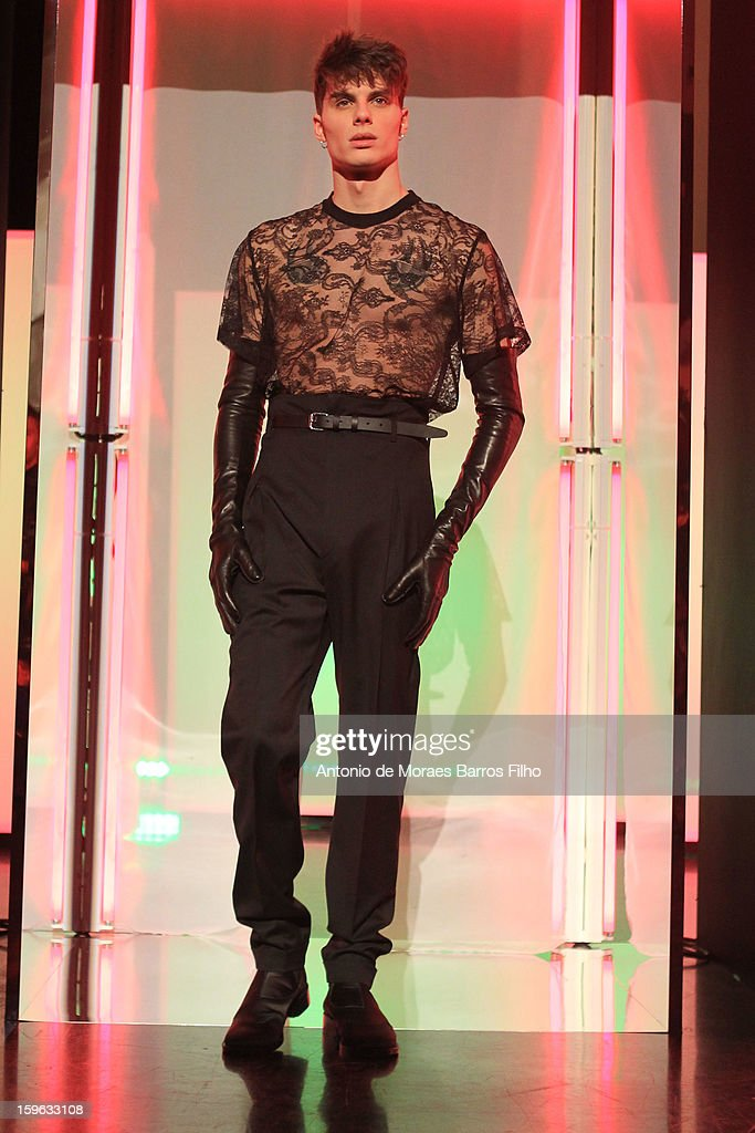 A model walks the runway during the Jean Paul Gaultier Men Autumn / Winter 2013 show as part of Paris Fashion Week.