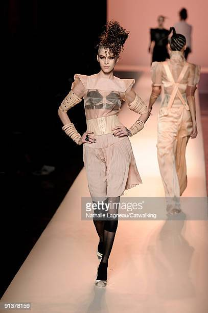 A model walks the runway during the Jean Paul Gaultier Pret a Porter show during Paris Womenswear Fashion Week Spring/Summer 2010 at 325 Rue Saint...