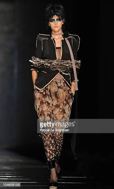 A model walks the runway during the Jean Paul Gaultier Ready to Wear Spring/Summer 2011 show during Paris Fashion Week on October 2 2010 in Paris...
