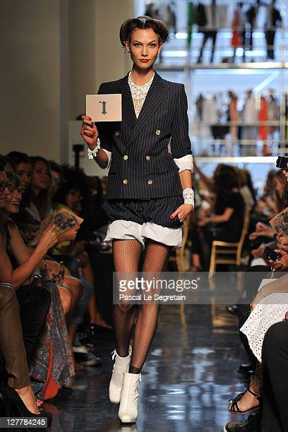 A model walks the runway during the Jean Paul Gaultier Ready to Wear Spring / Summer 2012 show during Paris Fashion Week on October 1 2011 in Paris...