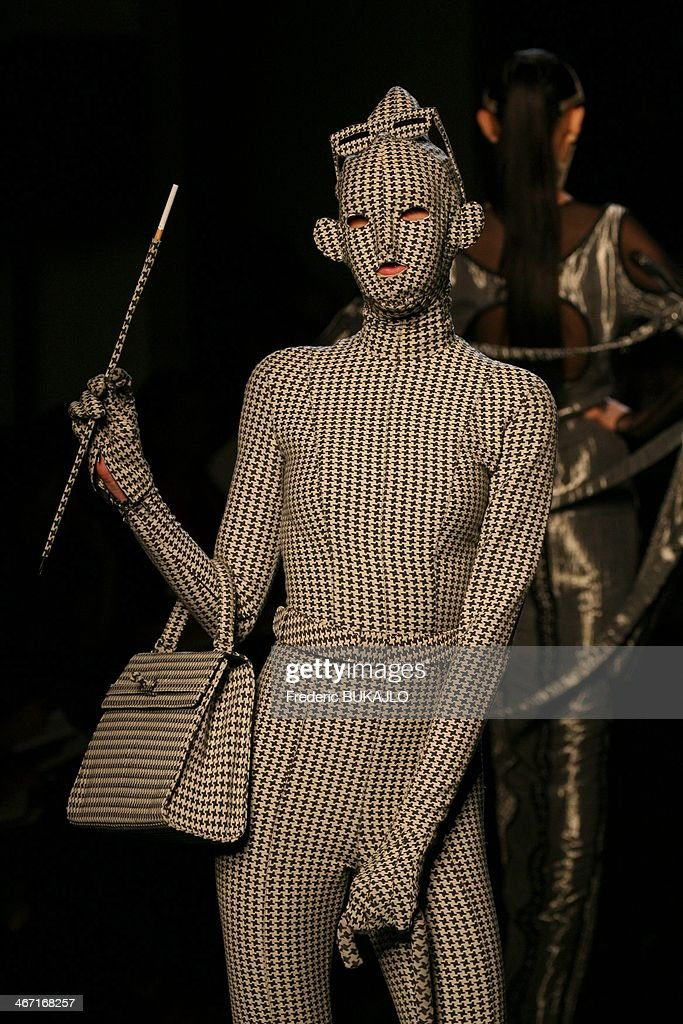 A model walks the runway during the Jean Paul Gaultier Ready to Wear Spring/Summer 2006-0027 show in Paris, France on October 3, 2006 - Jean Paul Gaultier celebrates 30 years of creation.