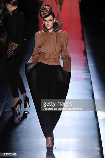 A model walks the runway during the Jean Paul Gaultier show as part of Paris Fashion Week HauteCouture Fall/Winter 20132014 at 325 Rue Saint Martin...