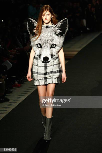 A model walks the runway during the JeanCharles De Castelbajac Fall/Winter 2013 ReadytoWear show as part of Paris Fashion Week on March 5 2013 in...