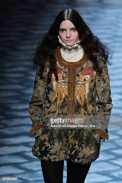 A model walks the runway during the JeanCharles de Castelbajac Ready to Wear show as part of the Paris Womenswear Fashion Week Fall/Winter 2011 at Le...