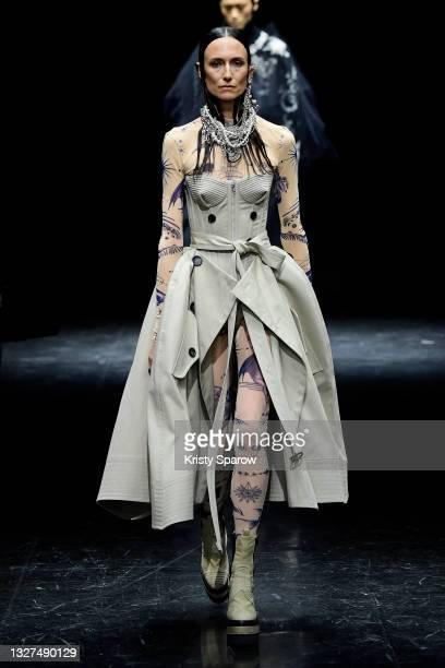 Model walks the runway during the Jean-Paul Gaultier Couture Haute Couture Fall/Winter 2021/2022 show as part of Paris Fashion Week on July 07, 2021...