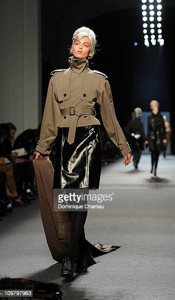 A model walks the runway during the JeanPaul Gaultier Ready to Wear Autumn/Winter 2011/2012 show during Paris Fashion Week at Atelier JeanPaul...