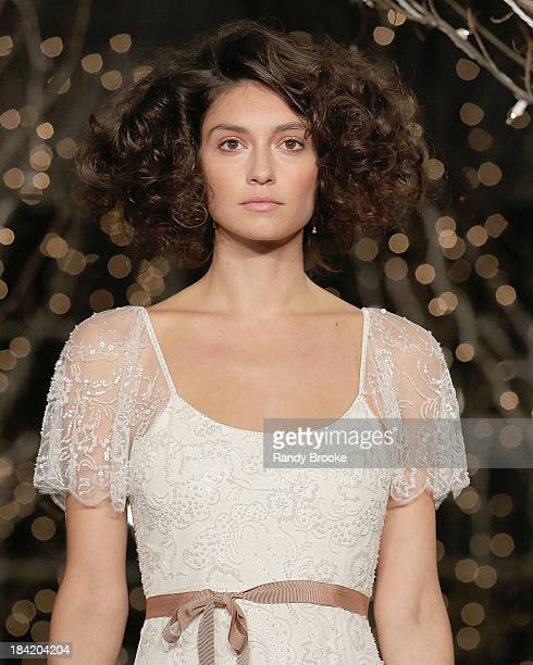 A model walks the runway during the Jenny Packham Fall 2014 Bridal collection show 25th anniversary reception on October 11 2013 in New York City