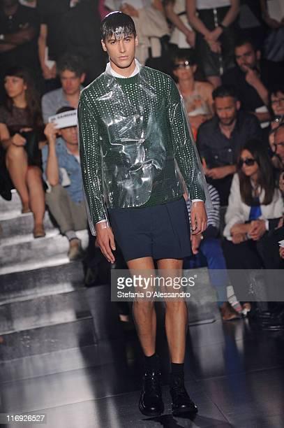 Model walks the runway during the Jil Sander fashion show as part of Milan Fashion Week Menswear Spring/Summer 2012 on June 18, 2011 in Milan, Italy