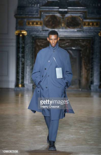 Model walks the runway during the Jil Sander Menswear Fall/Winter 2019-2020 show as part of Paris Fashion Week on January 18, 2019 in Paris, France.