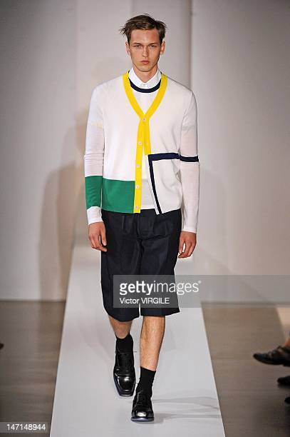 Model walks the runway during the Jil Sander ready to Wear Spring/Summer 2013 show as part of the Milan Men Fashion Week on June 23, 2012 in Milan,...