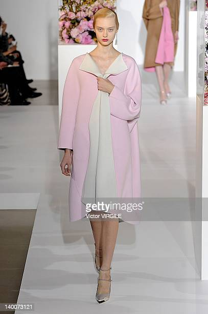 Model walks the runway during the Jil Sander Ready to Wear Fall/Winter 2012-2013 show as part of the Milan Fashion Week on February 25, 2012 in...