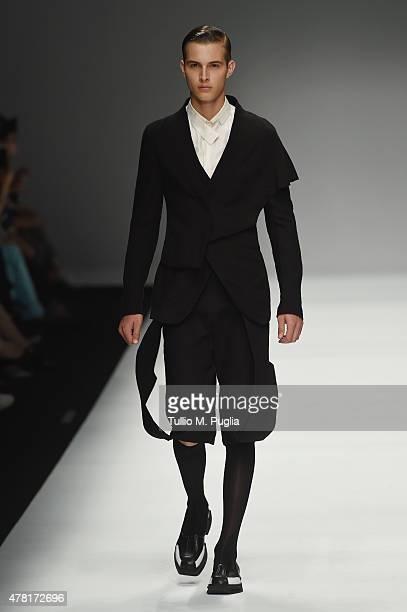 A model walks the runway during the Jiwenbo fashion show as part of Milan Men's Fashion Week Spring/Summer 2016 on June 23 2015 in Milan Italy