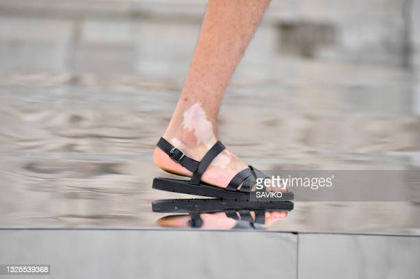 Model walks the runway during the JOEONE Ready to Wear Spring/Summer 2022 fashion show as part of the Paris Men Fashion Week on June 24, 2021 in...