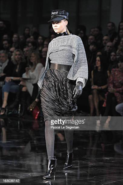 A model walks the runway during the John Galliano Fall/Winter 2013 ReadytoWear show as part of Paris Fashion Week at Le Centorial on March 3 2013 in...