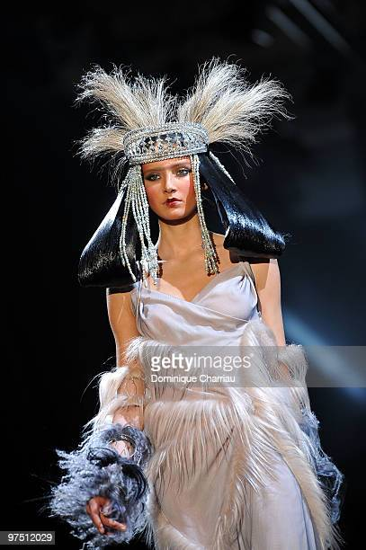 A model walks the runway during the John Galliano Ready to Wear show as part of the Paris Womenswear Fashion Week Fall/Winter 2011 at Halle...