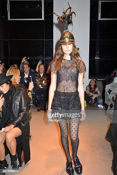 A model walks the runway during the John Galliano show as part of the Paris Fashion Week Womenswear Spring/Summer 2016 on October 4 2015 in Paris...