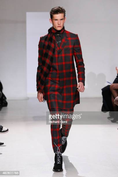 A model walks the runway during the John Lawrence Sullivan Menswear Fall/Winter 20142015 show as part of Paris Fashion Week on January 15 2014 in...