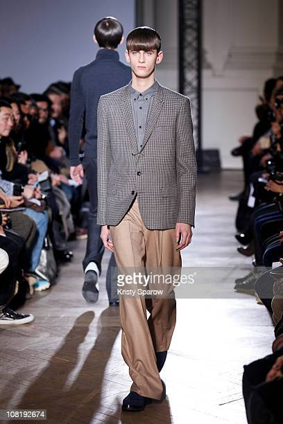 Model walks the runway during the John Lawrence Sullivan show as part of Paris Menswear Fashion Week Fall/Winter 2011-2012 at BMCS on January 20,...