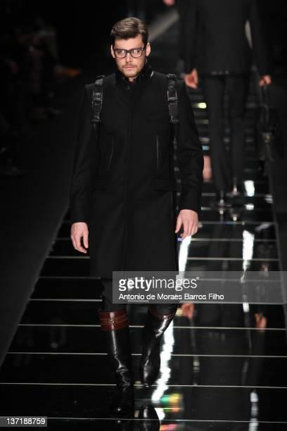 Model walks the runway during the John Richmond fashion show as part of Milan Fashion Week Menswear Autumn/Winter 2012 on January 16, 2012 in Milan,...