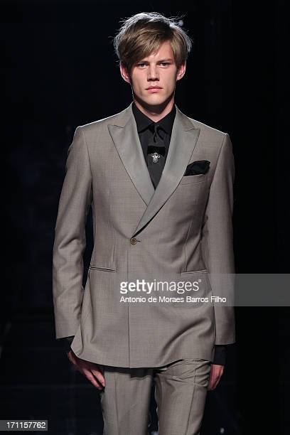 A model walks the runway during the John Varvatos show as a part of MFW S/S 2014 on June 22 2013 in Milan Italy