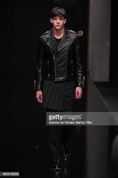 A model walks the runway during the Jonh Richmond show as a part of Milan Fashion Week Menswear Autumn/Winter 2014 on January 12 2014 in Milan Italy