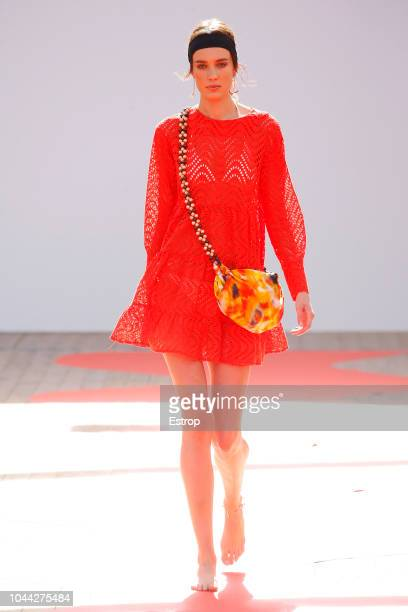 A model walks the runway during the Jour/ne show as part of the Paris Fashion Week Womenswear Spring/Summer 2019 on September 25 2018 in Paris France