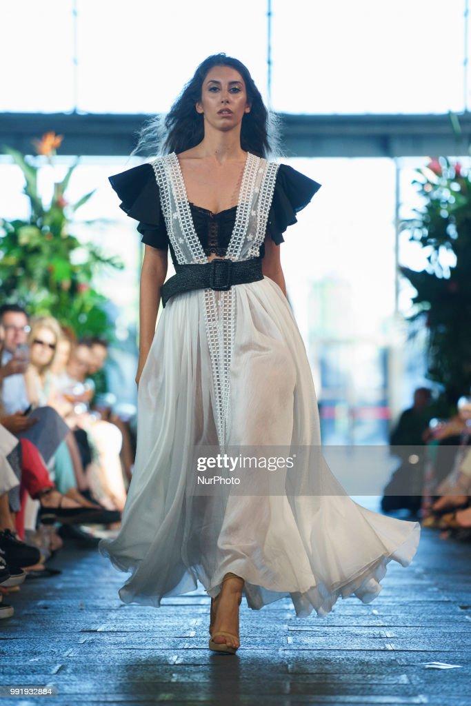 dd538fed8d9 A model walks the runway during the Juana Martin fashion show as ...