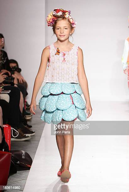 A model walks the runway during the Julia Passafiume preview at the Parsons The School For Design at petiteParade NY Kids Fashion Week in...