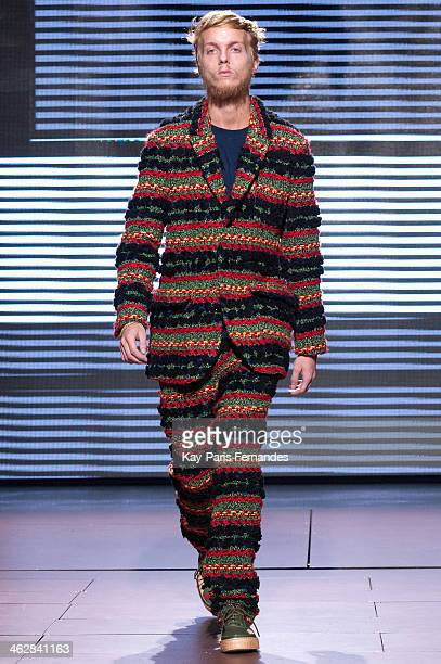 A model walks the runway during the Julien David Menswear Fall/Winter 20142015 Show as part of Paris Fashion Week on January 15 2014 in Paris France