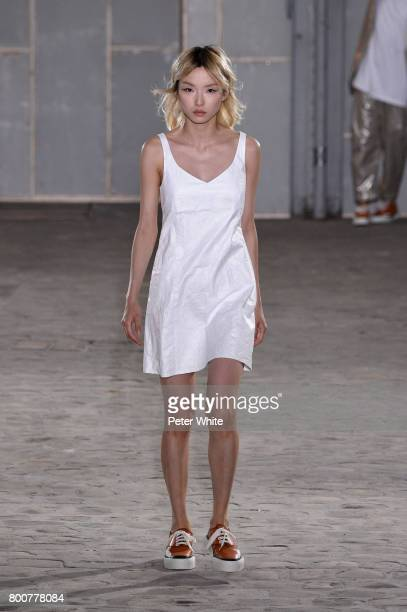 A model walks the runway during the Julien David Menswear Spring/Summer 2018 show as part of Paris Fashion Week on June 25 2017 in Paris France