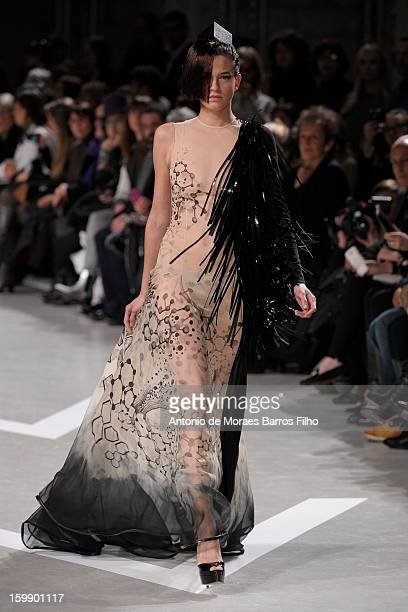 Model walks the runway during the Julien Fournie Spring/Summer 2013 Haute-Couture show as part of Paris Fashion Week at Cite de l'Architecture et du...
