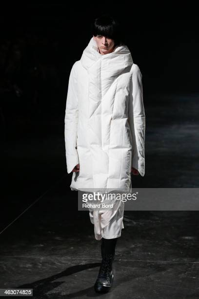 A model walks the runway during the Julius Menswear Fall/Winter 20142015 show as part of Paris Fashion Week on January 16 2014 in Paris France