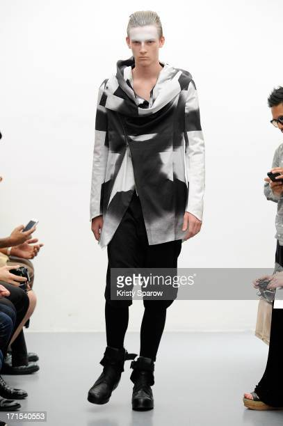 A model walks the runway during the Julius Menswear Spring/Summer 2014 show as part of Paris Fashion Week on June 26 2013 in Paris France