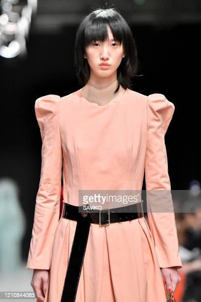 A model walks the runway during the Junko Shimada Ready to Wear fashion show as part of Paris Fashion Week Womenswear Fall/Winter 20202021 on March...