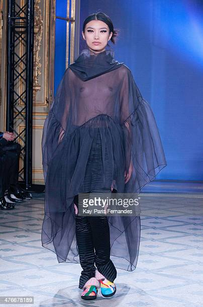 A model walks the runway during the Junko Shimada show as part of the Paris Fashion Week Womenswear Fall/Winter 20142015 on March 4 2014 in Paris...