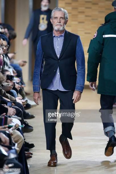 Model walks the runway during the Junya Watanabe Men Menswear Fall/Winter 2019-2020 show as part of Paris Fashion Week on January 18, 2019 in Paris,...