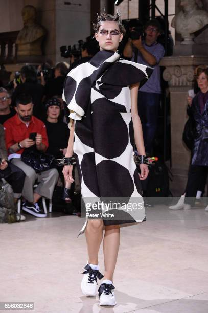 A model walks the runway during the Junya Watanabe show as part of the Paris Fashion Week Womenswear Spring/Summer 2018 on September 30 2017 in Paris...