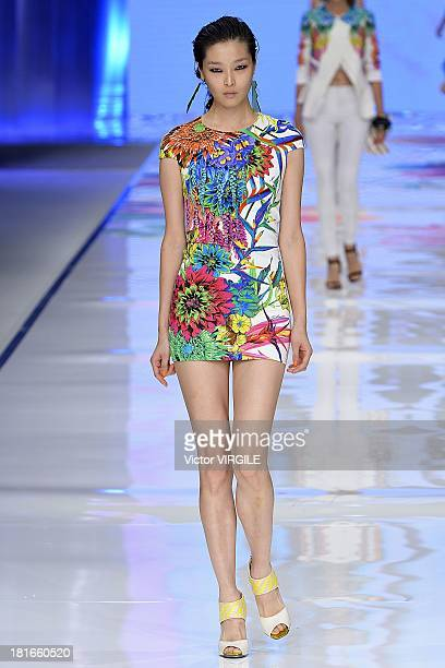 A model walks the runway during the Just Cavalli show as a part of Milan Fashion Week Womenswear Spring/Summer 2014 on September 19 2013 in Milan...