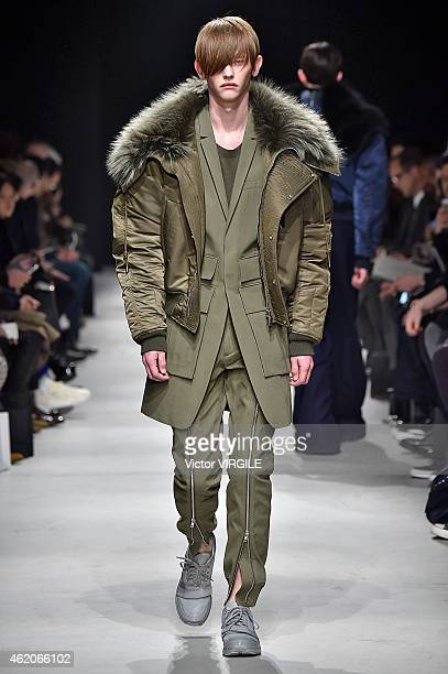 A model walks the runway during the JuunJ Menswear Fall/Winter 20152016 show at Palais de Tokyo as part of the Paris Fashion Week on January 23 2015...