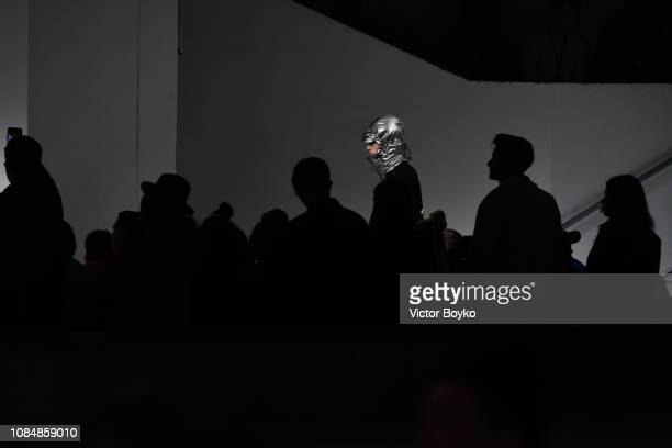 A model walks the runway during the JuunJ Menswear Fall/Winter 20192020 show as part of Paris Fashion Week on January 18 2019 in Paris France
