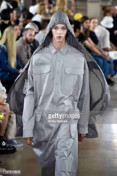A model walks the runway during the JuunJ Menswear Spring Summer 2020 show as part of Paris Fashion Week on June 21 2019 in Paris France